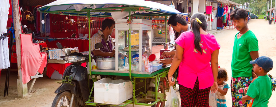 People-buying-food-from-the-mobile-shop-on-the-market-in-Khao-Lak-Thailand